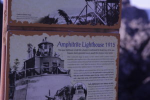 Trail sign explaining Amphitrate Lighthouse